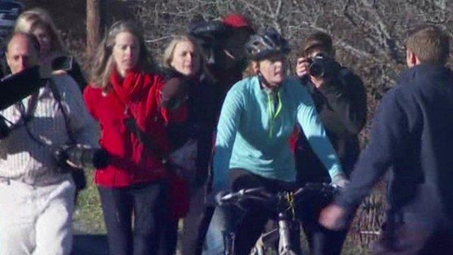 Kaci Hickox riding her bike